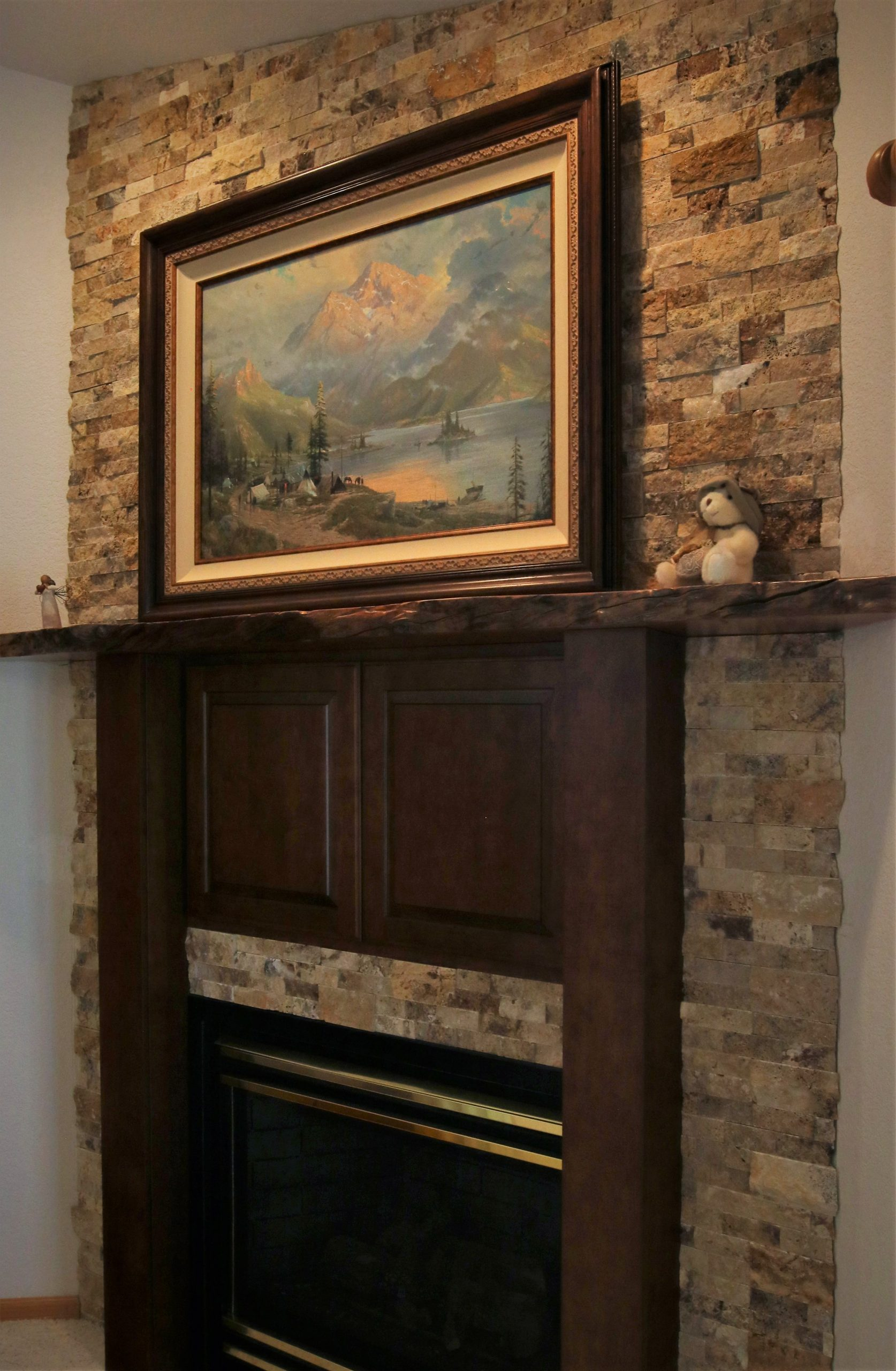 Stacked Stone Fireplace with Cherry Wood Mantel