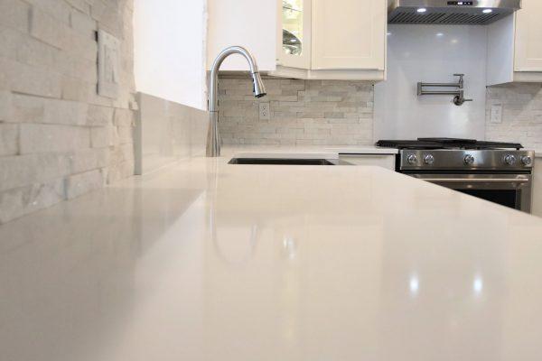 Quartz Countertops with Stacked Stone Backsplash